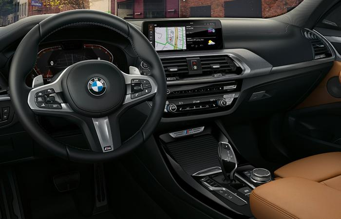 2021 BMW X3 in steering wheel and infotainment system view