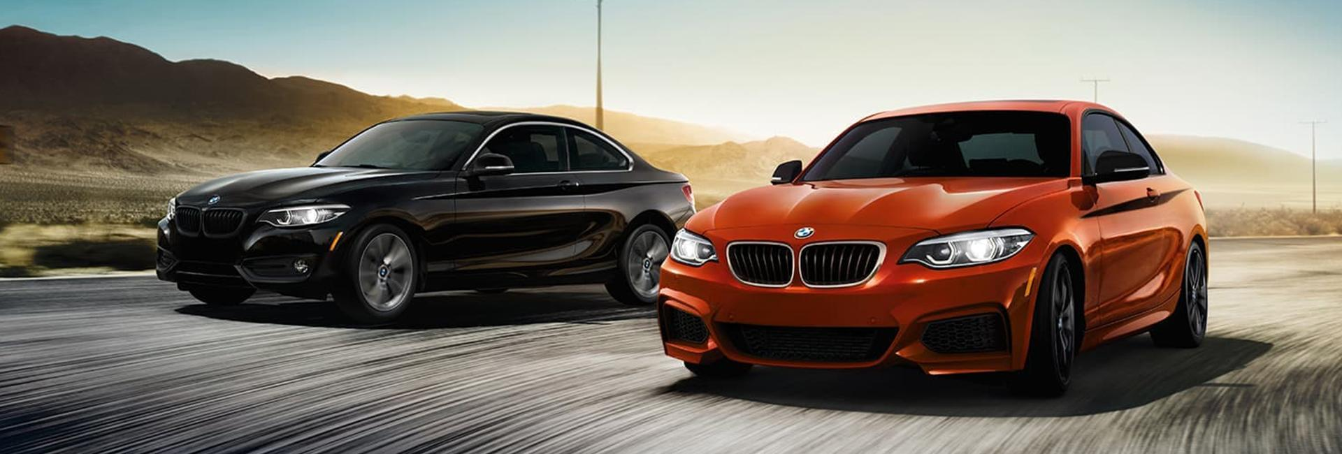 Two BMW 2 Series side by side in motion