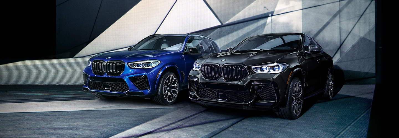 Black and blue BMW cars parked adjacently