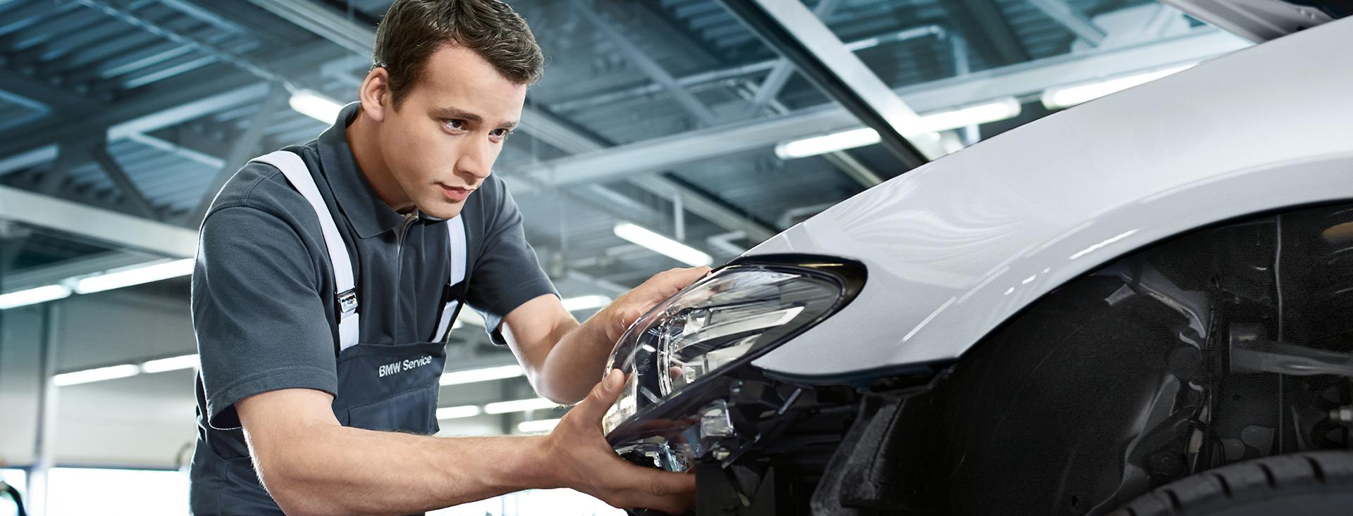 Service professional replacing a headlight