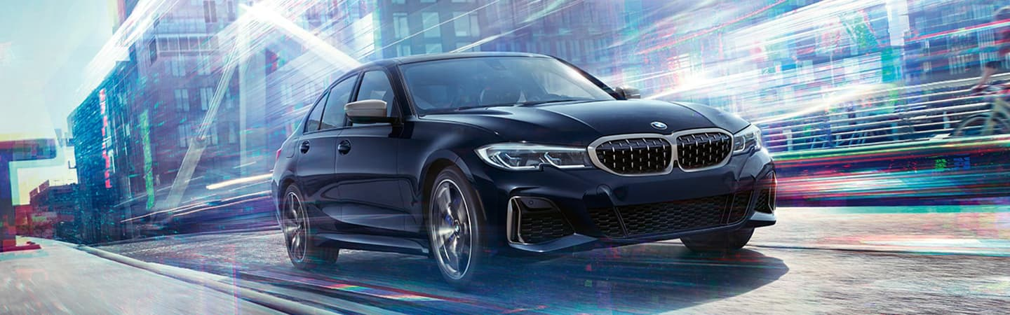 Black 2020 BMW 3 Series Driving - Front End