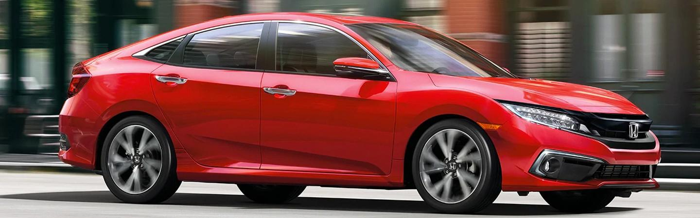 Red 2021 Honda Civic in motion