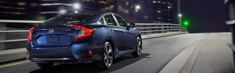 Rear passenger view of a Blue Honda Civic