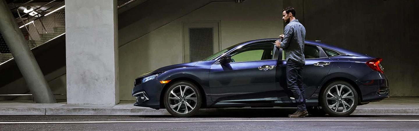 A man getting into the 2021 Honda Civic
