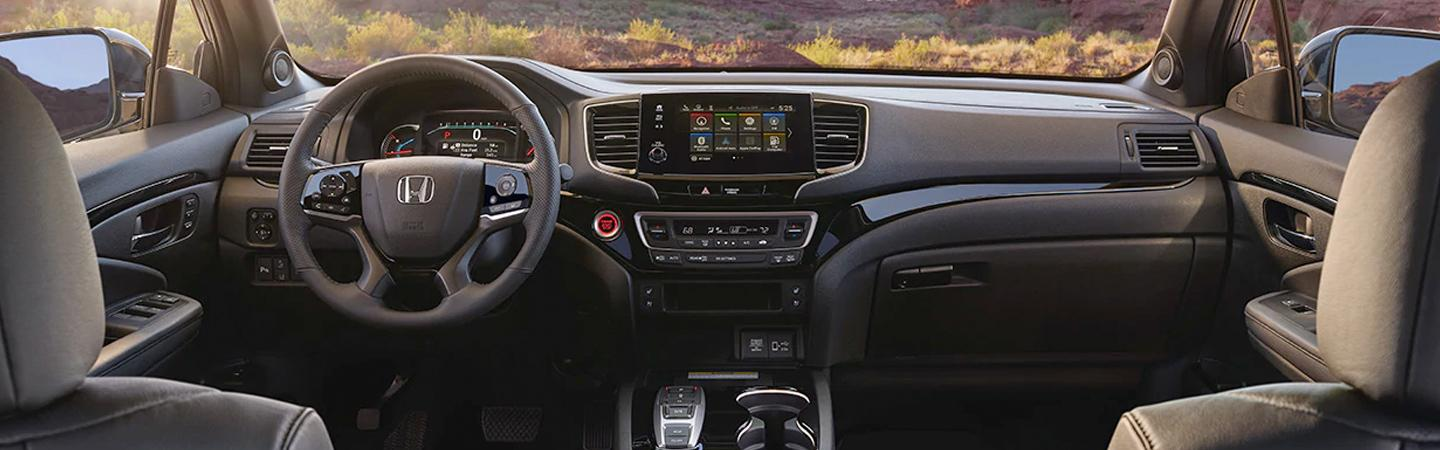 Interior view of the steering wheel and infotainment system