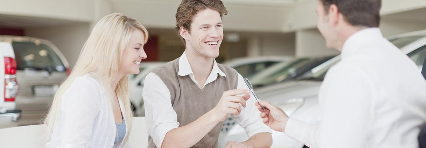A Honda finance professional assisting with a new Honda customer