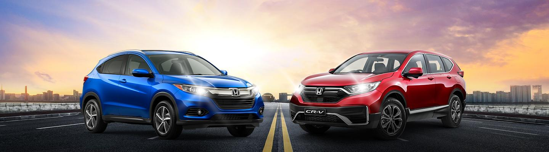 A Honda CR-V and a HR-V parked side by side.