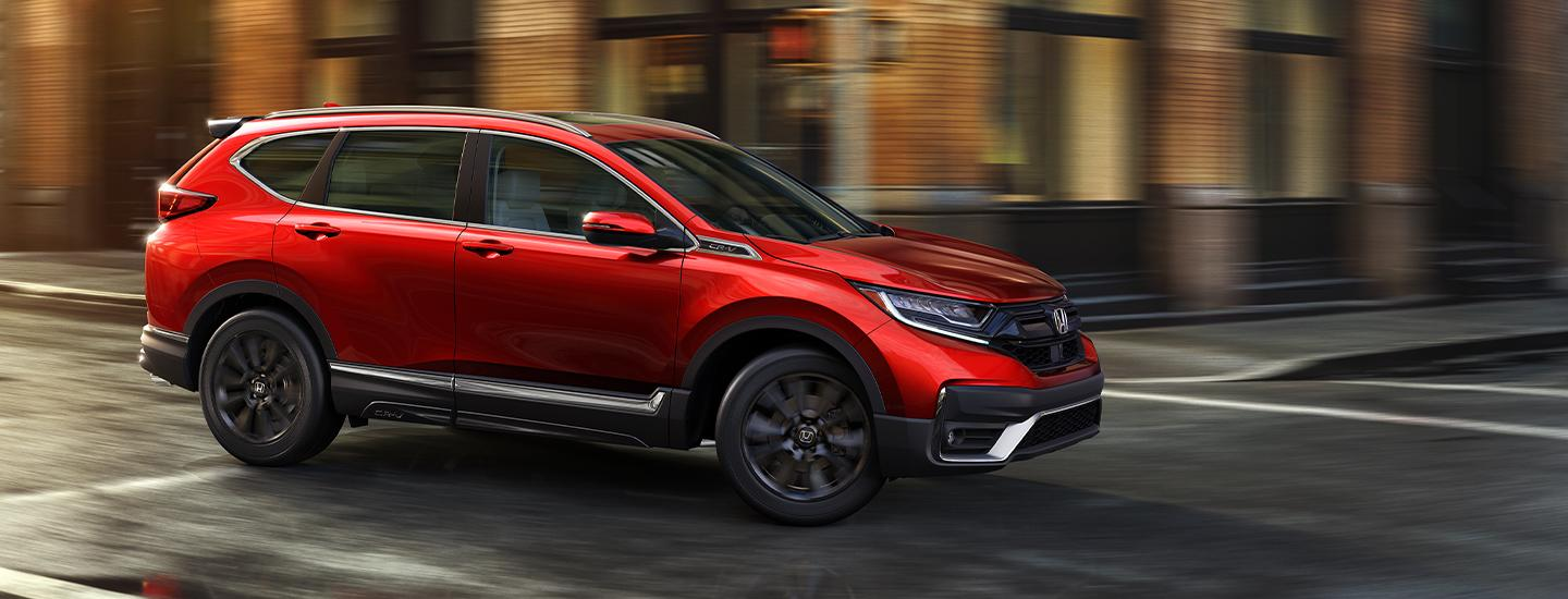 Red CR-V in motion throughout Miami, FL