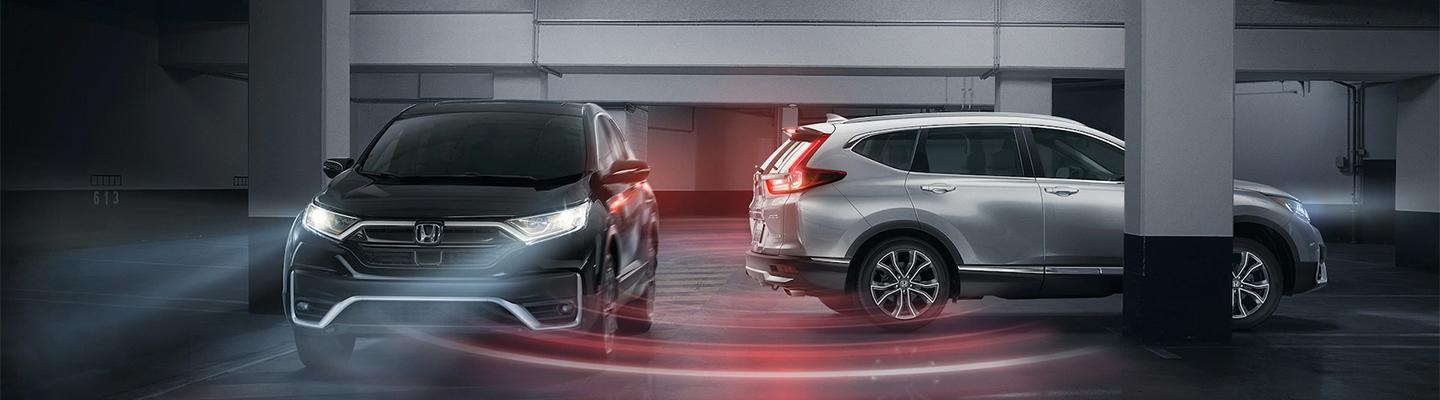 Two Honda CR-V's using technology to keep safe at a parking garage