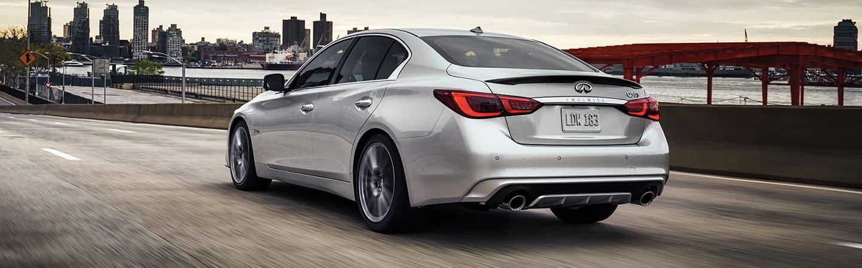 Silver 2020 INFINITI Q50 Driving - Rear