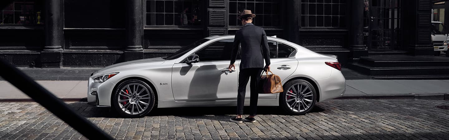 White 2020 INFINITI Q50 parked on the side of the road