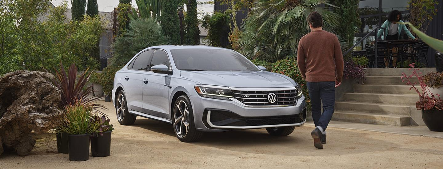 A man walking in front of a 2021 Passat