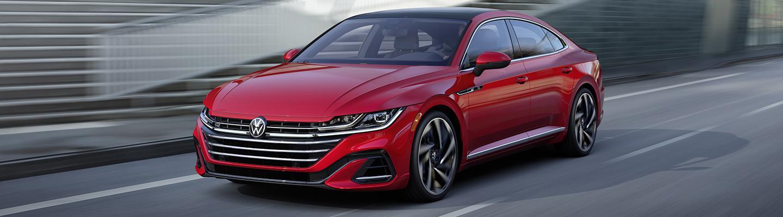 A red 2021 Volkswagen Arteon in motion