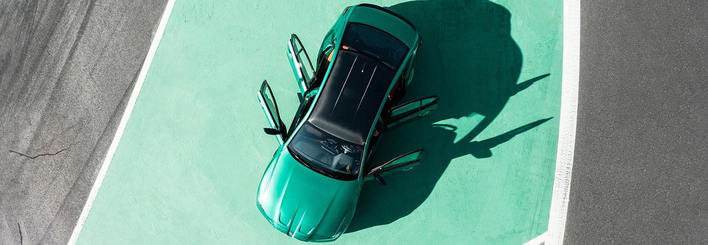Overhead view of a green BMW vehicle with its doors open