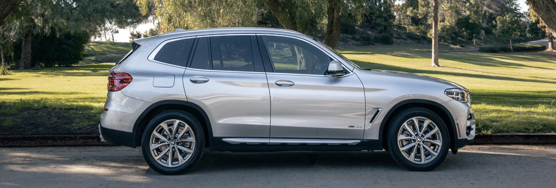 Side profile view of the 2021 BMW X3 parked