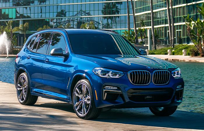 Front passenger view of the 2021 BMW X3 parked