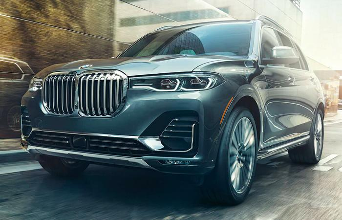 Front view of a gray 2021 BMW X7 in motion