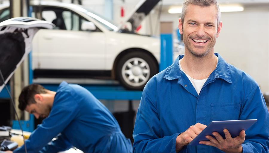 Service techs working together to diagnose and repair.