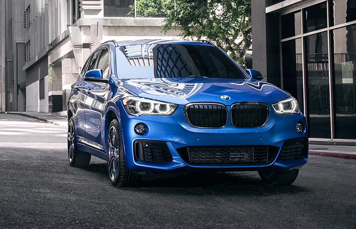 Front view of a blue 2021 BMW X1