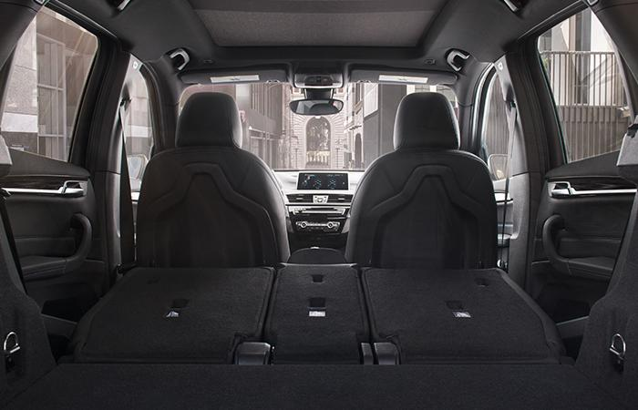 Interior view of the 2021 BMW X1 with the rear seats folded down