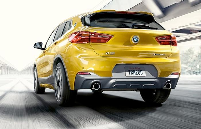 Rear view of the 2021 BMW X2 in motion