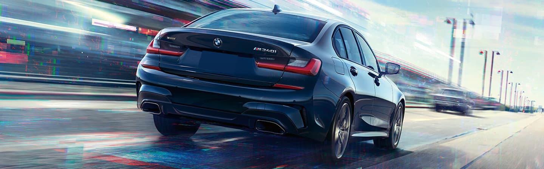 Black 2020 BMW 3 Series Driving - Rear End