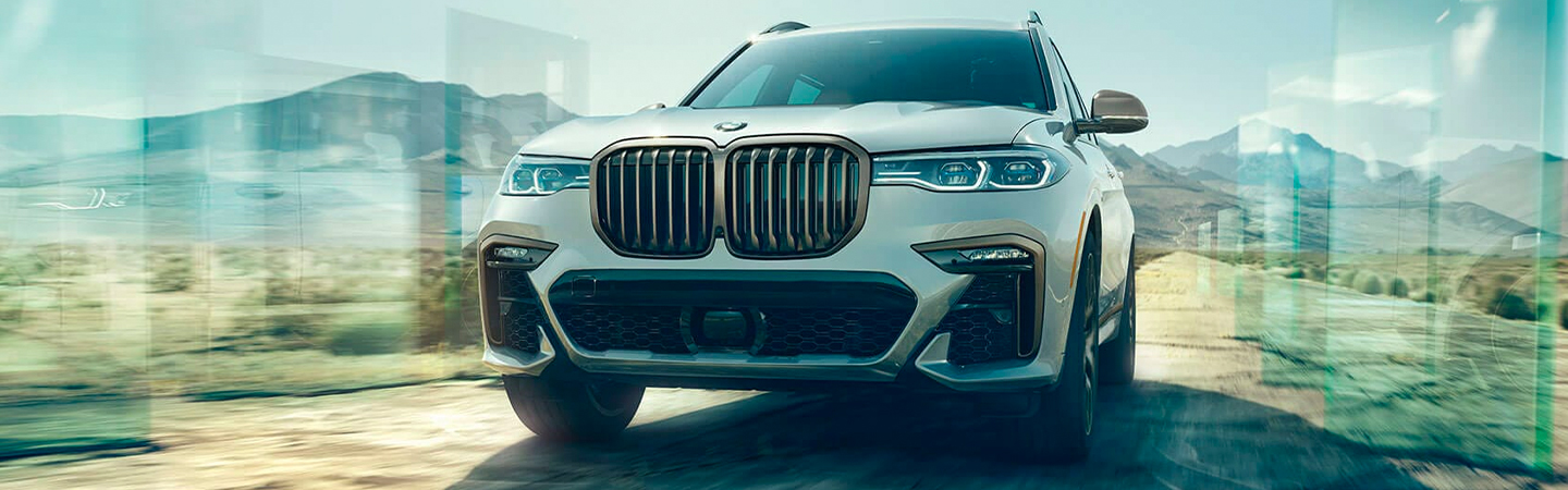 White 2020 BMW X7 Driving Off Road - Front View