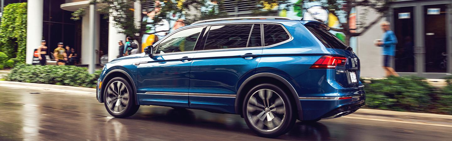 Rear profile view of a blue 2021 Tiguan