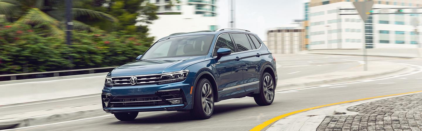 Front driver profile of a blue Tiguan