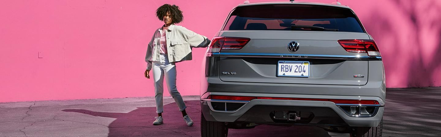 A person next to the 2021 Atlas Cross Sport