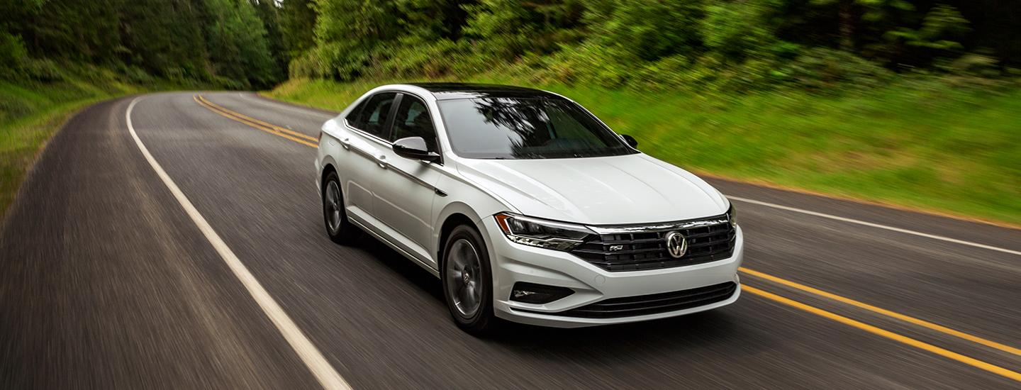 Front driver view of the 2021 VW Jetta in motion