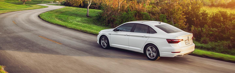 White VW Jetta in motion