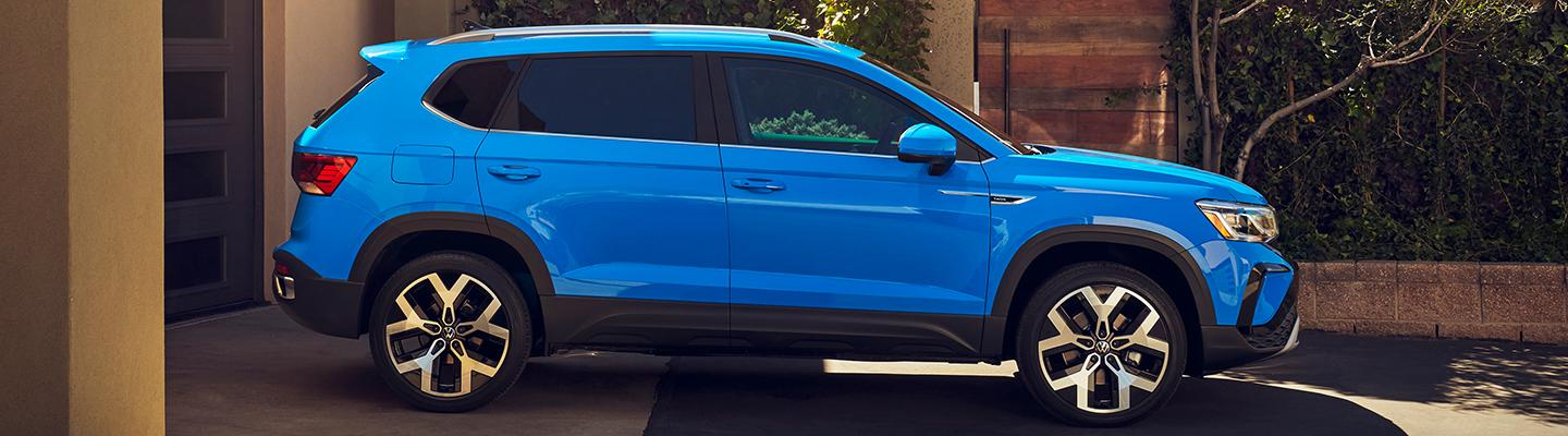 Side profile view of a blue 2021 VW Taos