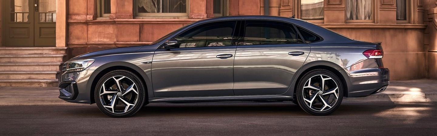 Full side profile view of a 2021 gray Passat in motion