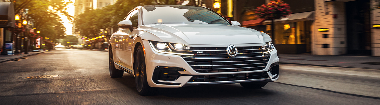 Front view of a white 2021 Arteon in motion