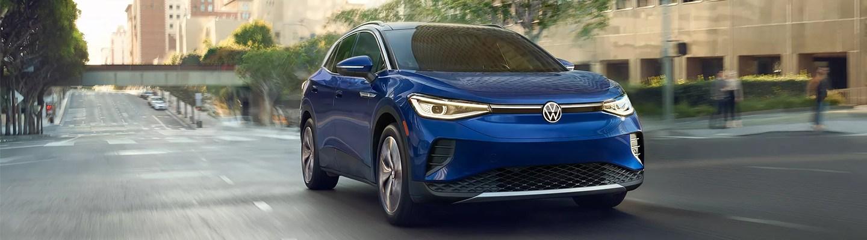 The metallic blue electric Volkswagen in motion