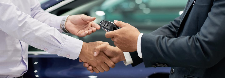 vw vista dealer giving vw car key to customer