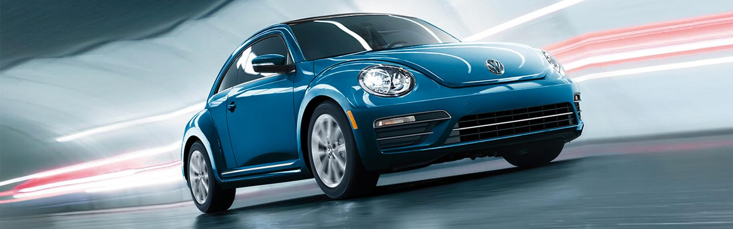 Blue 2019 Volkswagen Beetle Driving through a tunnel.